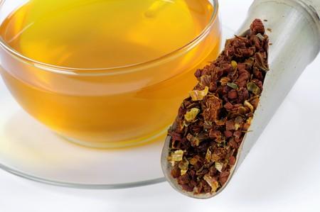 wooden scoop: Gardenia fruits in wooden scoop with a cup of tea