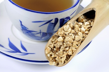angelica sinensis: Chinese angelica root with a cup of tea