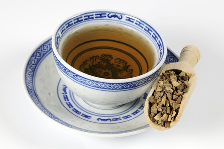 teas: Bowl of tea with dried peel of the green Curaçao orange