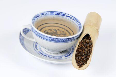 semen: Tazza di t� con Semen cassiae in una canna di bamb�
