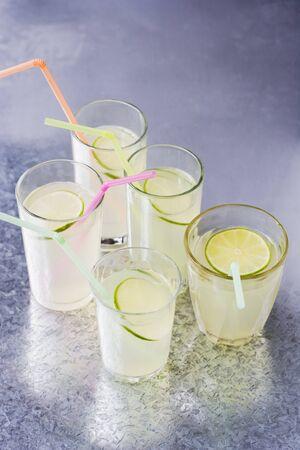 soda pops: Five glasses of lemonade with straws LANG_EVOIMAGES