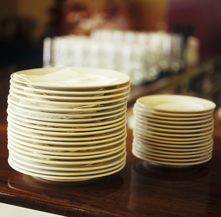 in twos: Two piles of plates LANG_EVOIMAGES