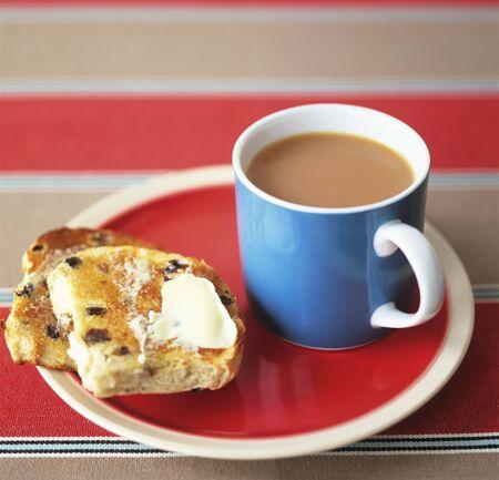 teacake: Toasted teacake with tea (UK)