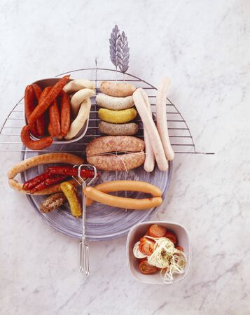 grilled sausages: A selection of raw and grilled sausages
