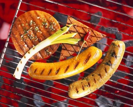 aaa: Tofu and tofu sausages on a barbecue