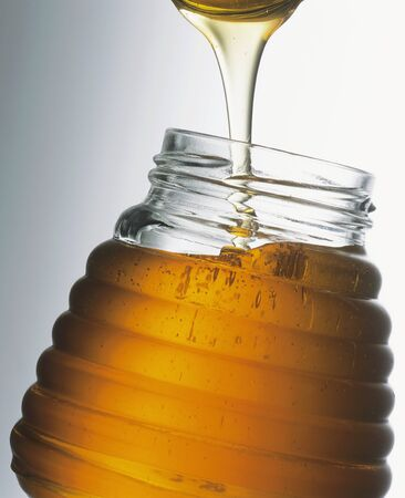 no movement: Honey in jar with spoon