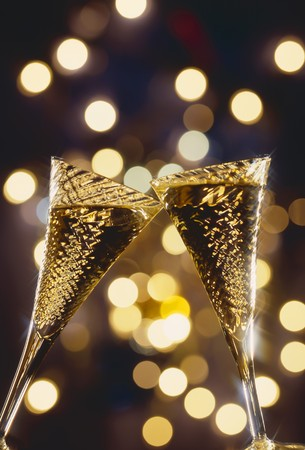 champers: Two glasses of sparkling wine being clinked together