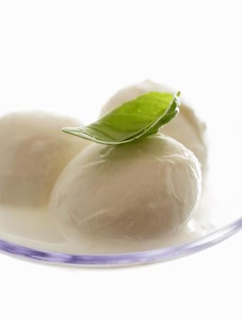 aaa: Mozzarella with basil on plastic spoon