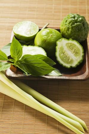 kafir lime: Limes, kaffir limes, Thai basil and lemon grass LANG_EVOIMAGES