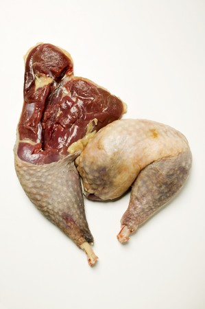 in twos: Two guinea-fowl legs