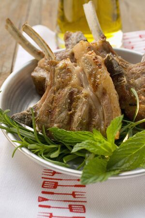 qs: Grilled lamb cutlets, fresh herbs, olive oil