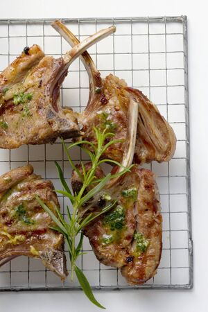qs: Grilled lamb cutlets with herb oil and rosemary
