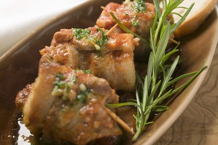 pine kernels: Belly pork rolls with tomato pesto and rosemary
