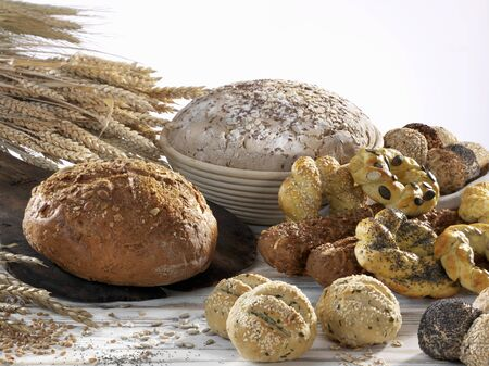several breads: An assortment of wholemeal loaves and rolls