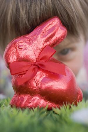 sweet grasses: Child looking at red Easter Bunny