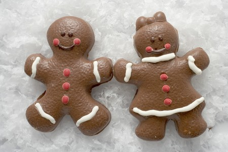 christmassy: Two Christmassy chocolate-coated gingerbread people in snow