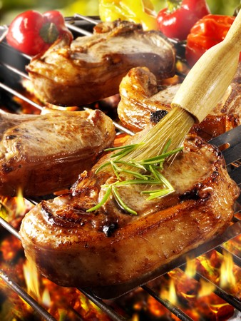 qs: Brushing pork chop on barbecue rack with oil