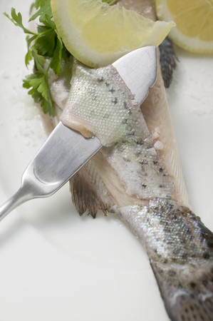 salmo trutta: Removing trout skin with a fish knife