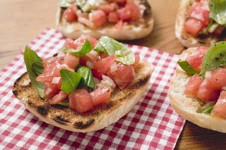 several breads: Bruschetta with tomato salsa and basil