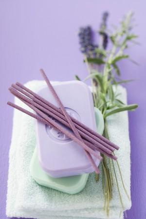 incense sticks: Incense sticks & bars of soap on towel, sprig of lavender LANG_EVOIMAGES