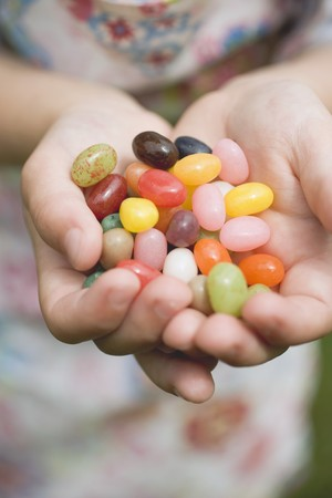 jellybean: Childs hands holding coloured sugar eggs