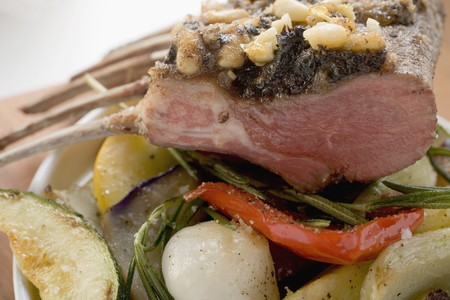 pine kernels: Rack of lamb with pesto crust and pine nuts on vegetables