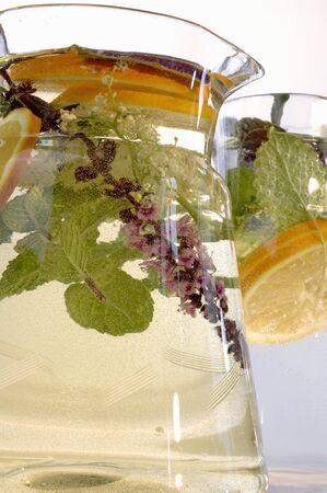 soda pops: Herbal drink with slices of lemon in glass jug