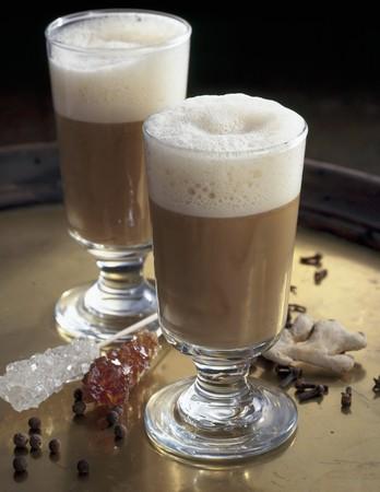 grog: Beer grog in two glasses, spices, sugar swizzle sticks