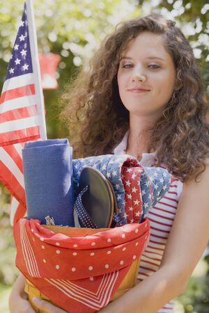 18 25 year old: Young woman at a 4th of July garden party (USA) LANG_EVOIMAGES