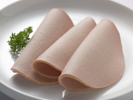 veal sausage: Three slices of Gelbwurst (pork and veal sausage)