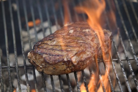 no movement: Beef steak on a barbecue
