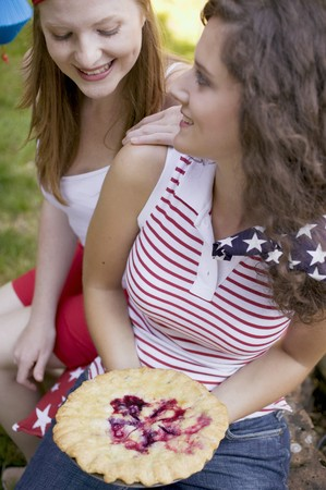 blueberry pie: Women with blueberry pie at a 4th of July picnic (USA)