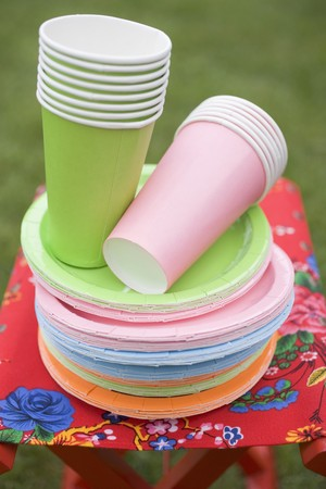 Coloured paper cups and plates on folding stool in garden & Coloured Paper Cups And Plates On Folding Stool In Garden Stock ...
