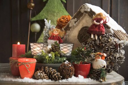 pine wreaths: Christmas decorations on table out of doors LANG_EVOIMAGES