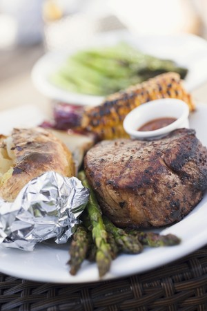 zea: Grilled beef steak, asparagus, baked potato, corn on the cob