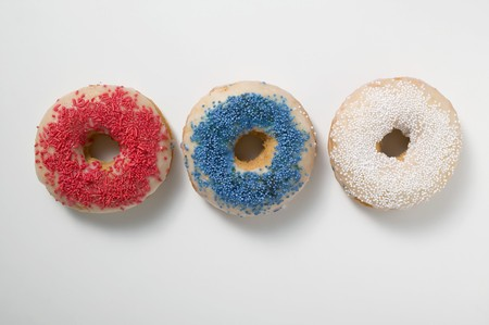 jimmies: Three doughnuts with sprinkles (red, blue, white)