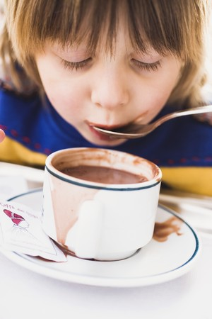 slurp: Child slurping cocoa from a spoon