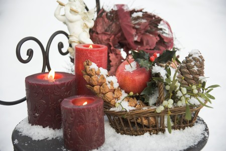 Christmas decorations on snow-covered garden table LANG_EVOIMAGES