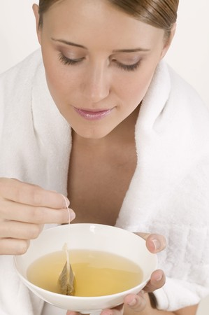 25 to 30 year olds: Woman with white towel and bowl of tea