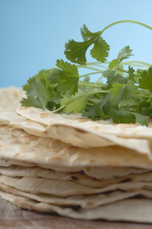 tortillas: Tortillas, stacked, with fresh coriander LANG_EVOIMAGES