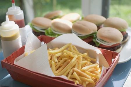 barbecues: Chips, hamburgers, mustard and ketchup