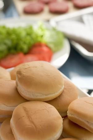 qs: Hamburger buns, salad and burgers