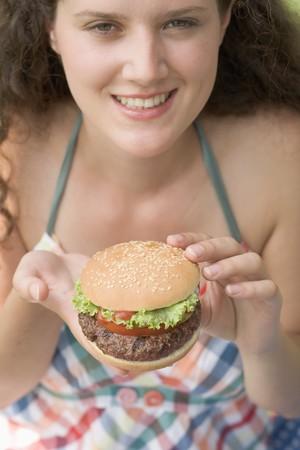 barbie: Woman holding hamburger LANG_EVOIMAGES