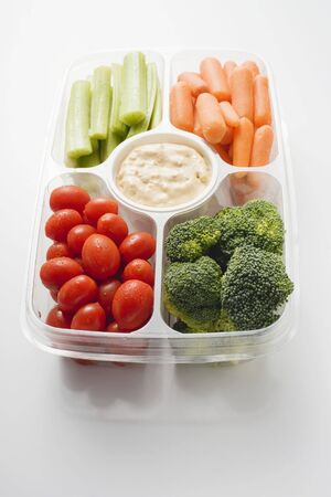 crudite: Assorted vegetables with dip in plastic tray LANG_EVOIMAGES