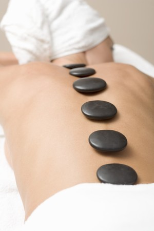 complementary therapy: Woman having LaStone Therapy (healing therapy using stones) LANG_EVOIMAGES