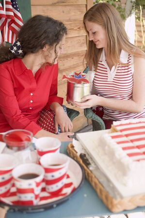 eating area: Two women with cake, cookies & coffee on the 4th of July (USA)