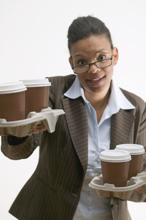 four year olds: Businesswoman holding four cups of coffee