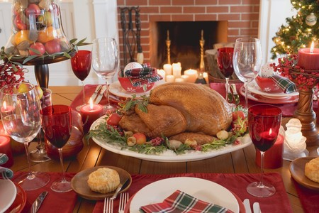 entire: Christmas table with turkey in front of fireplace (USA)