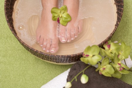 well beings: Woman enjoying a soothing foot bath