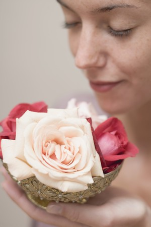 spoiling: Woman holding a bowl of roses